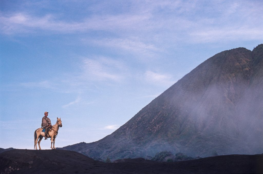 Mr. Satumat, the horseman with Mount Bromo in background